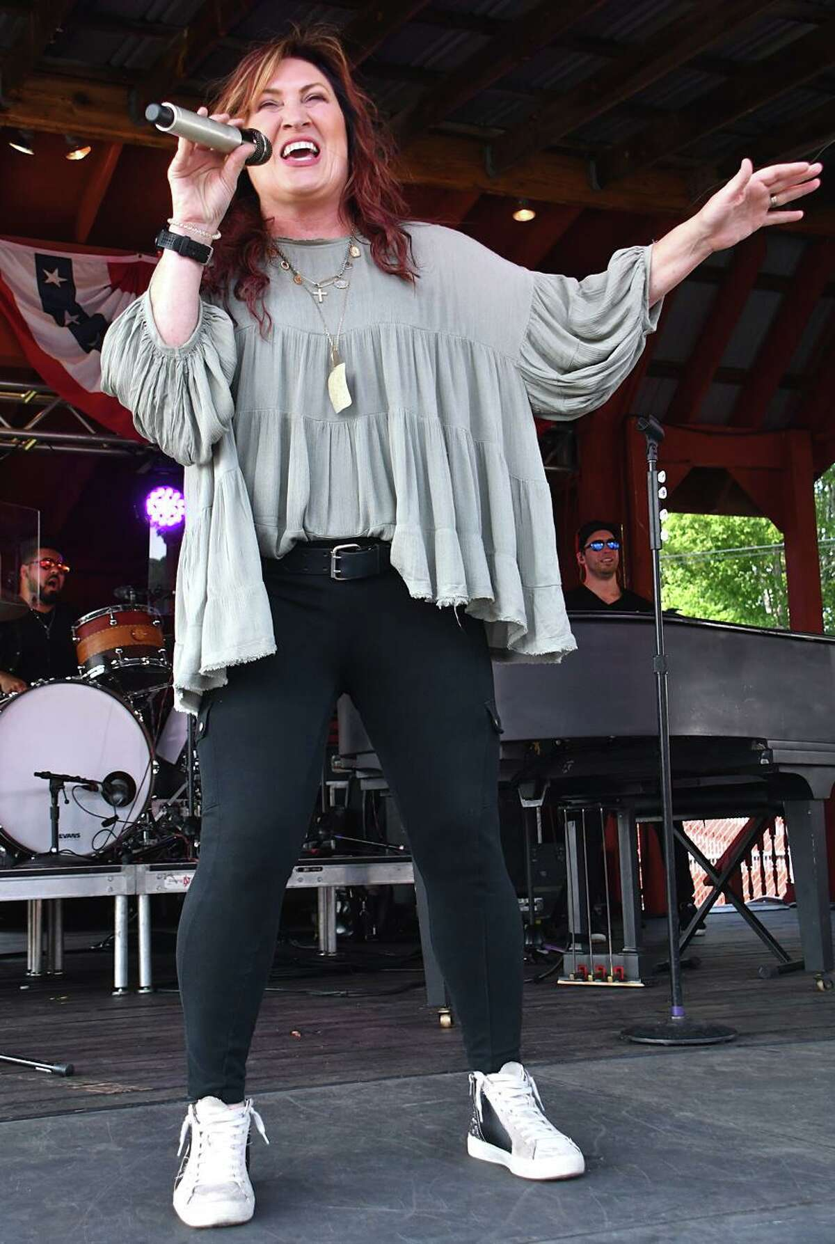 Singer, songwriter and guitarist Jo Dee Messina is shown performing on stage during her Sept. 12 concert at the Hebron Fairgrounds, Hebron. She has charted six number one singles on the Billboard country music charts. She has been honored by the Country Music Association and the Academy of Country Music, and has been nominated for two Grammy Awards. To learn more you can visit www.jodeemessina.com