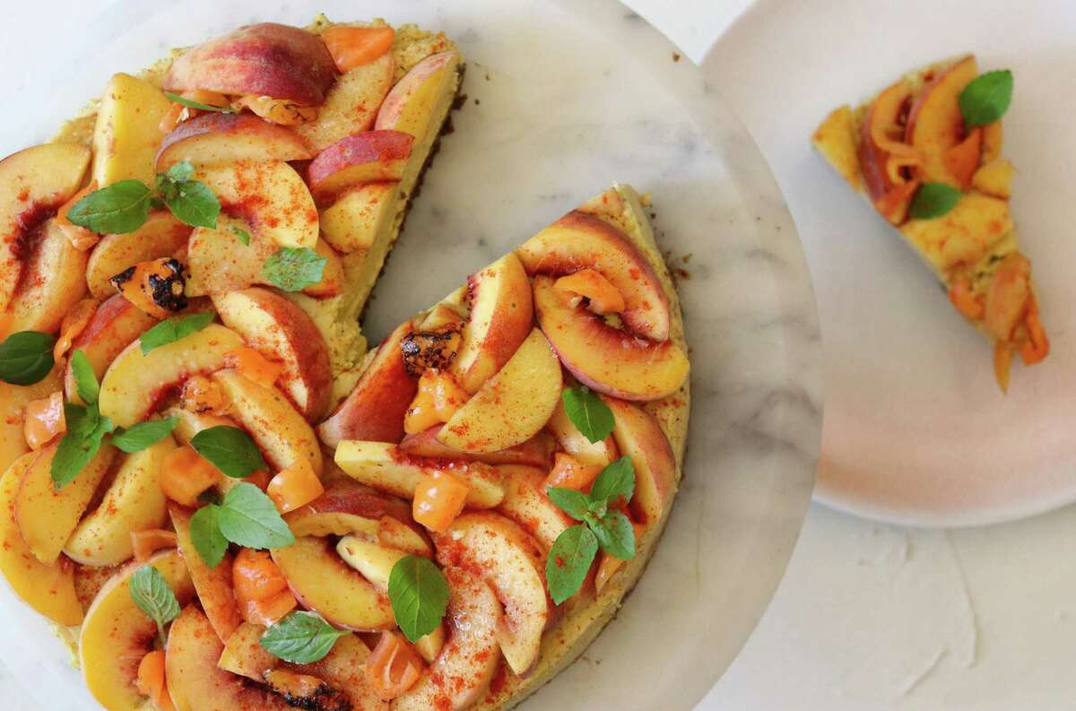 The cooling flavor of saffron is combined with peaches and roasted habanada peppers for this cheesecake.
