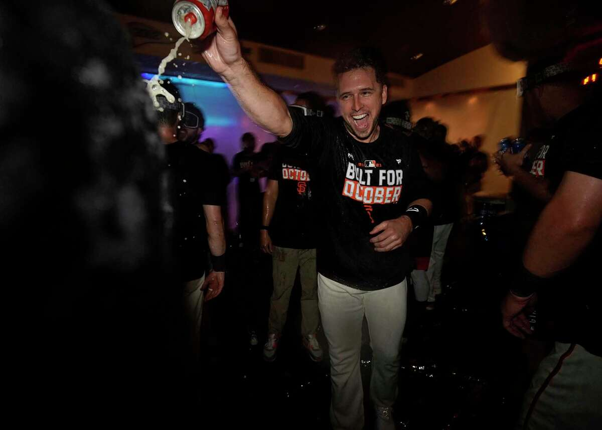 The San Francisco Giants celebrate in the clubhouse after clinching a playoff berth at Oracle Park in San Francisco, Calif., on Monday, September 13, 2021.