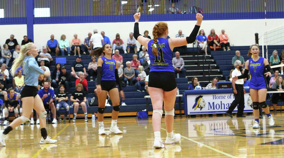 Members of the Morley Stanwood volleyball team celebrate winning a point during a recent match at home. (Pioneer photo/Joe Judd)