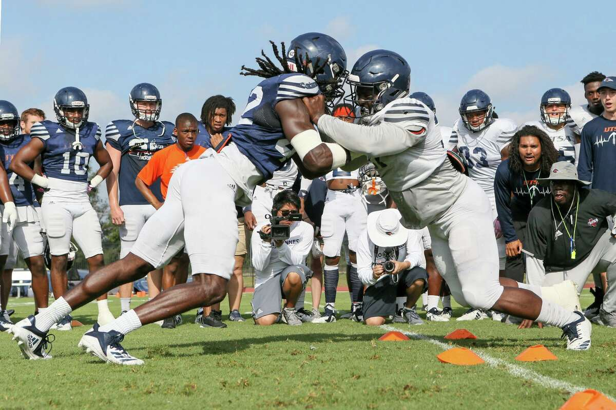 """UTSA football players square off during practice in 2019. Several readers have expressed disappointment in the university's decision to drop the """"Come and Take It"""" slogan, with one calling it a challenge to the opposing team during football games. ."""