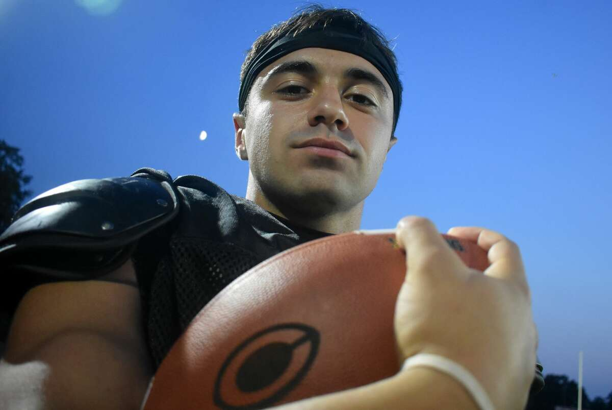 Cheshire senior Christian Russo is one of three players in Cheshire football history to start as a freshman and he is using his experience to help his teammates play catch up after the year off. Russo poses at the The Maclary Complex at Cheshire high school on Monday, Sept. 13, 2021.