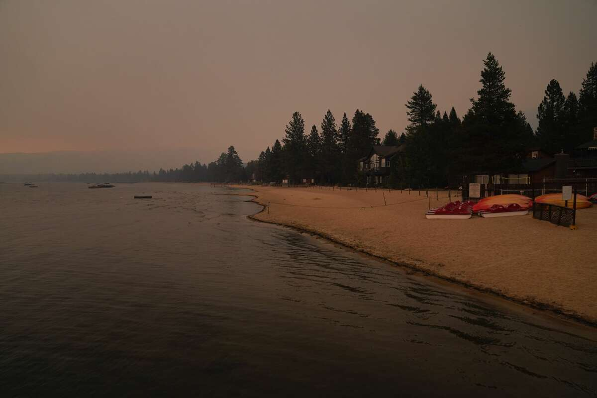 In this Tuesday, Aug. 31, 2021, file photo, an empty beach is seen after a mandatory evacuation was ordered because of the Caldor Fire in South Lake Tahoe, Calif.