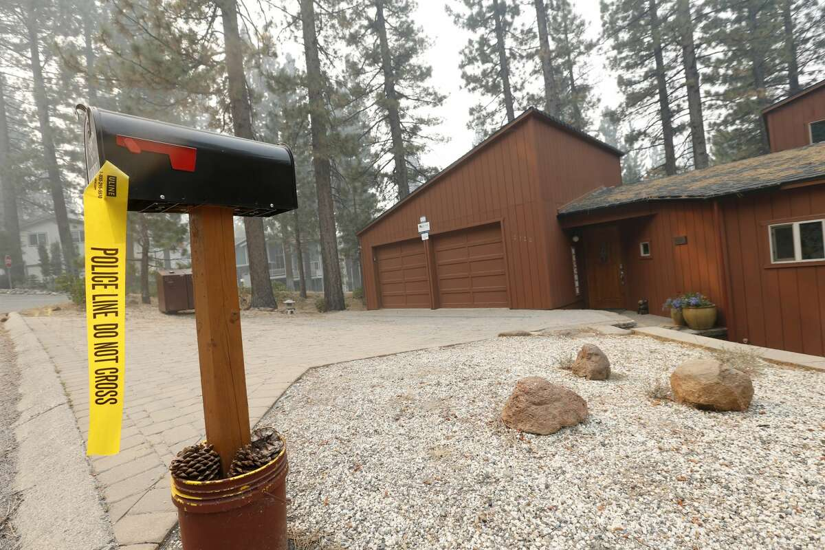 A tagged home is seen off Pioneer Trail as the Caldor Fire burns nearby in South Lake Tahoe, Calif., on Thursday, Sept. 2, 2021. More than 20,000 residents were evacuated.