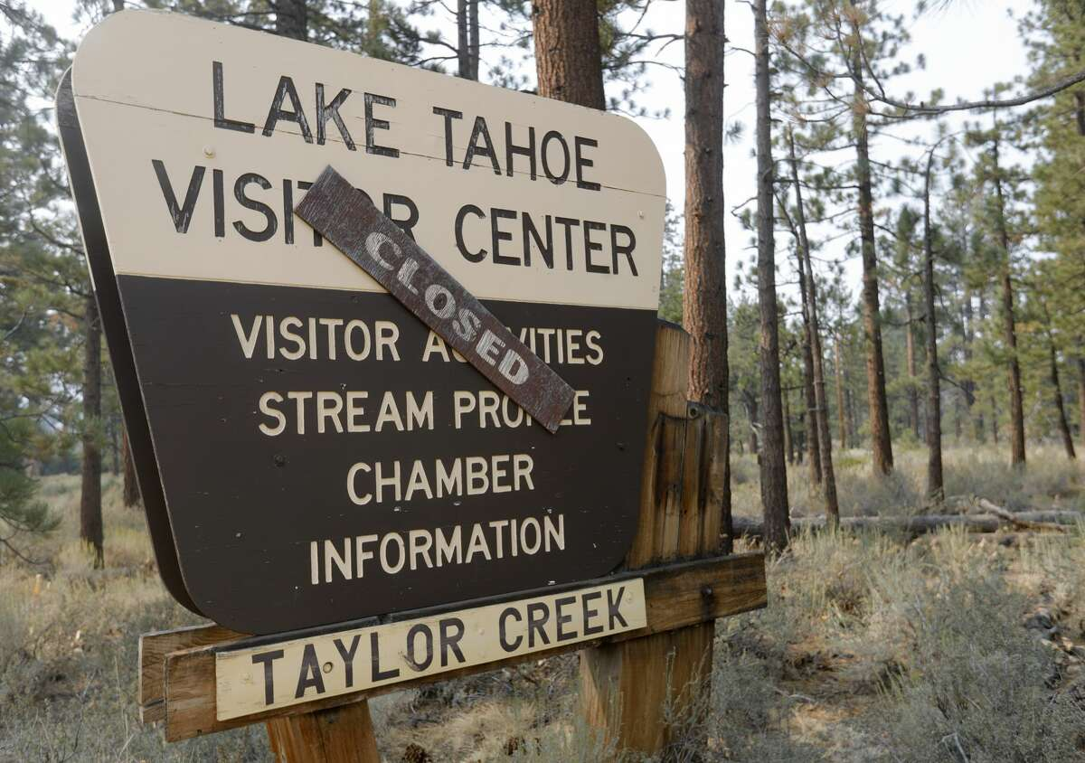 A sign is seen near Taylor Creek along Highway 89 as residents remain evacuated because of the Caldor Fire burning near South Lake Tahoe, Calif., on Saturday, Sept. 4, 2021.