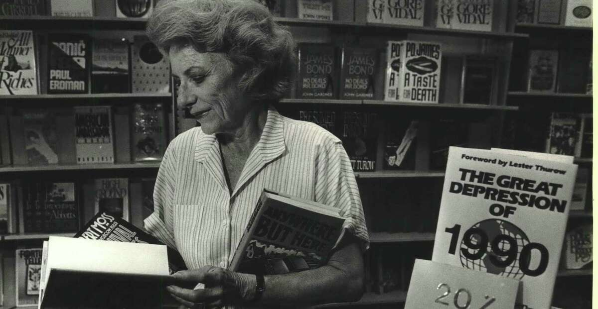 Camille Rosengren looks at books in her store Rosengren's Books in 1974. Rosengren died Sept. 11, 2021, from heart failure. She was 94.