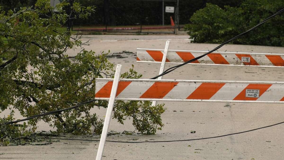 Hurricane Nicholas knocked down power lines across Houston, including here on Joplin Street in Park Place.