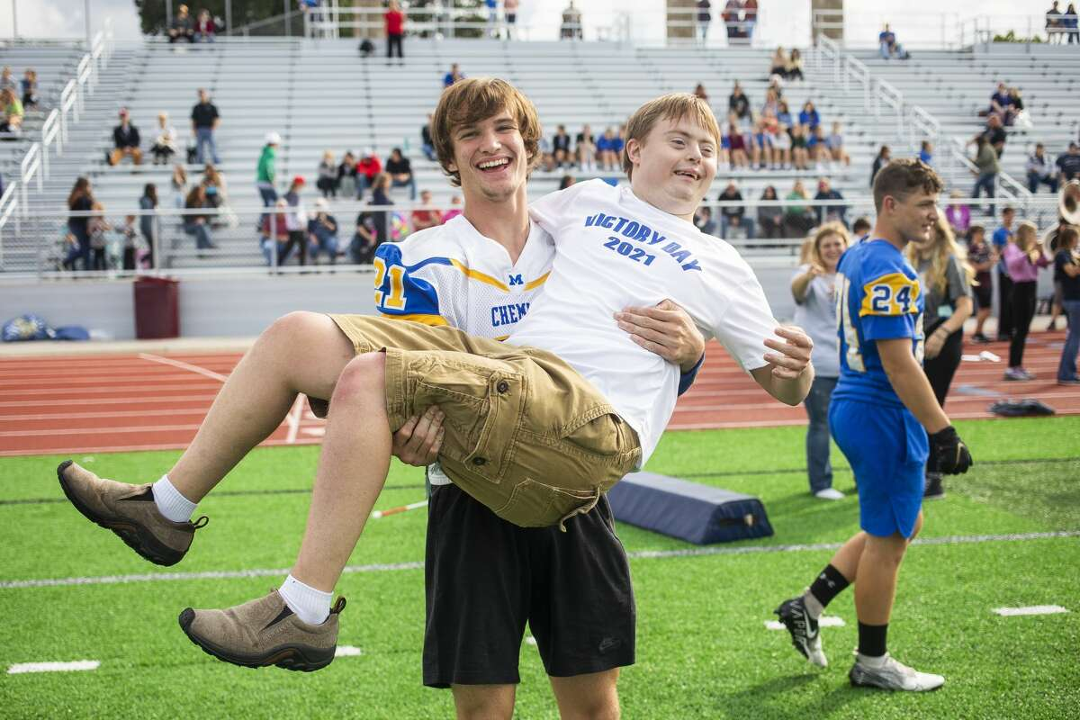 Midland High student Jared Walter, is lifted into the air by Sam Dauer during Victory Day, an event that celebrates inclusion, teamwork and unity, Monday, Sept. 13, 2021 at Midland Community Stadium. (Katy Kildee/kkildee@mdn.net)
