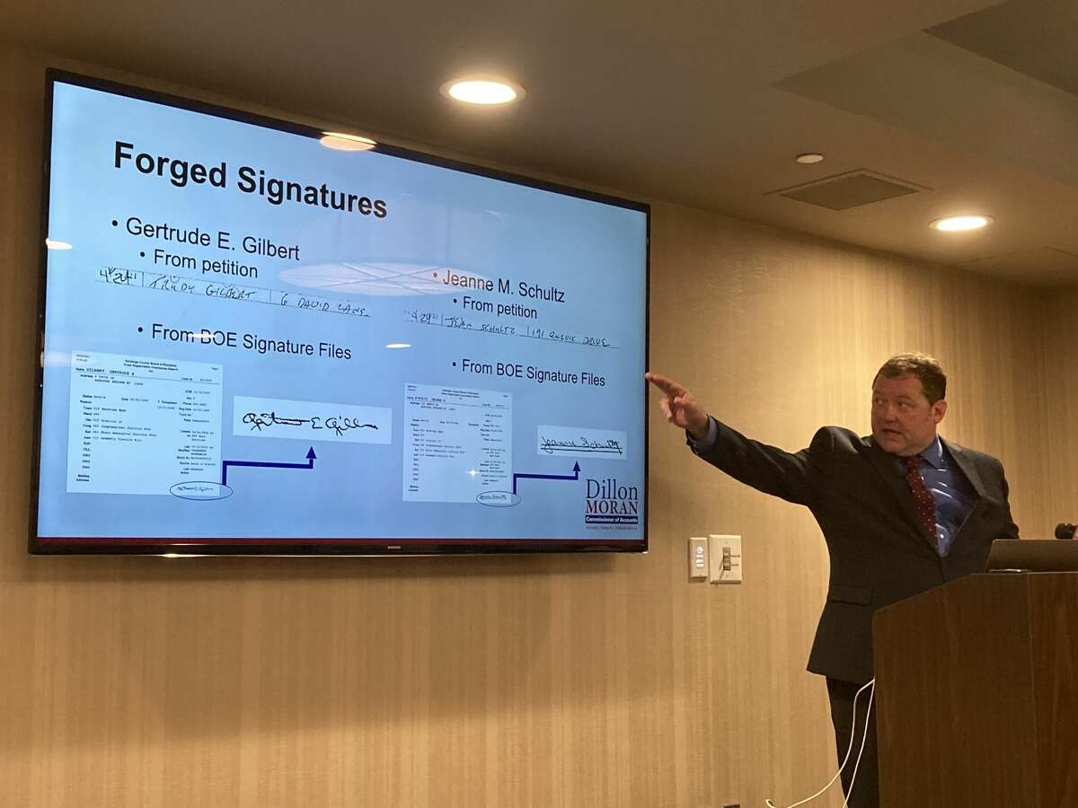Candidate for Commissioner of Accounts shows how he alleges the signatures on the petition ballot do not match up with those on file at the Saratoga County Board of Elections of his opponent on Sept. 14, 2021.