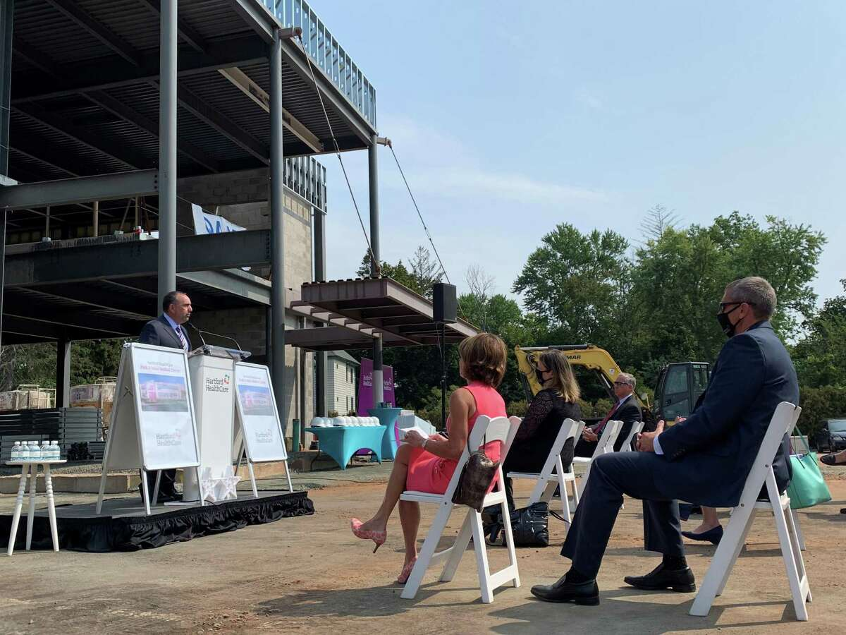 Jeffrey Flaks, the president and chief executive officer of Hartford HealthCare, speaks to guests at a preview event of the new medical center, located at the corner of South Main Street and Park Road.