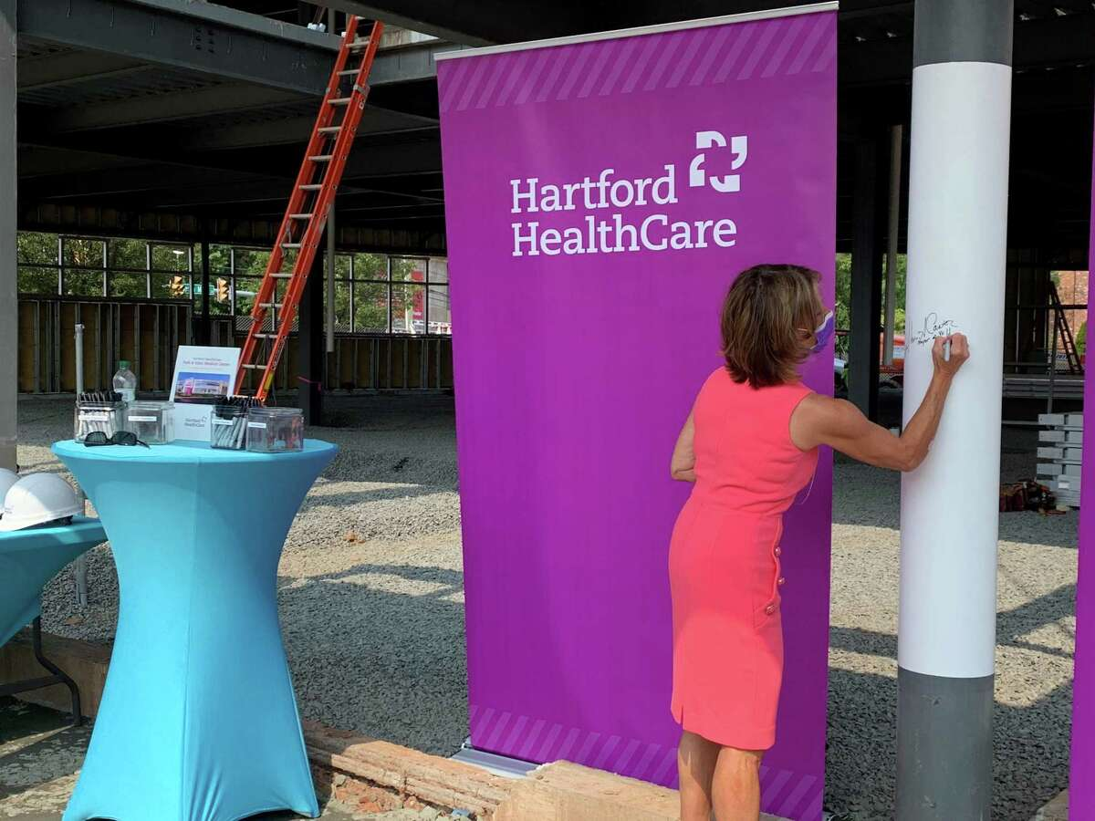 Mayor Shari Cantor participates in a pole signing to commemorate the construction of the new Hartford HealthCare medical center. Prior to this, Cantor spoke to the crowd, explaining why she's excited about the project.