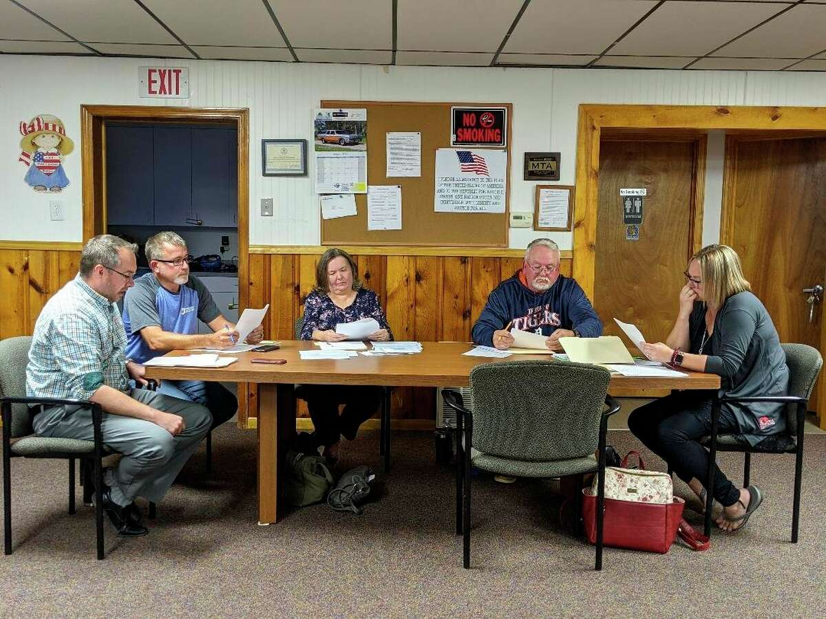 Beaverton Township Board of Trustees listens as trustee Joe Sprague reads complaints from a flyer that circulated in the county. From left, Trustees Joe Sprague, Tom Murray, Treasurer Louann Domako, Supervisor Tim Mickler and Clerk Katery Stoike. (Photo by Tereasa Nims/for the Daily News)