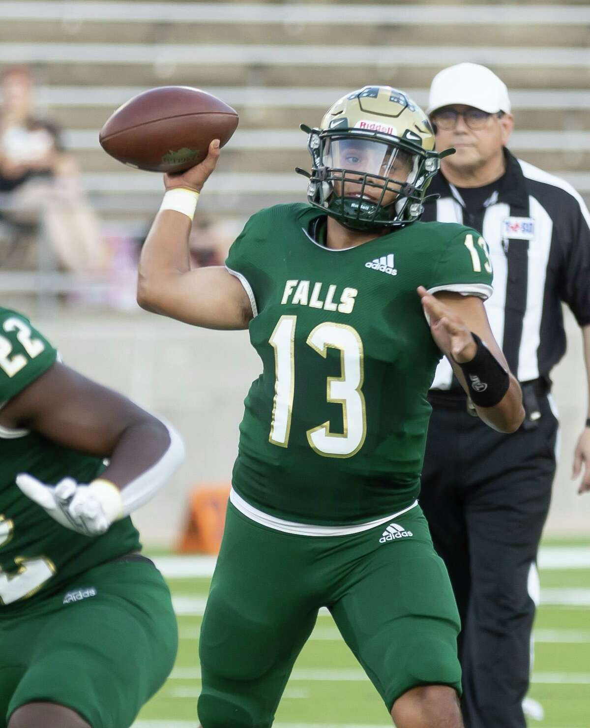 Cypress Falls quarterback Jonathan Valdez (13) throws during the first quarter of a non-district football game against Travis at Cy-Fair FCU Stadium, Saturday, Sept. 11, 2021, in Cypress.