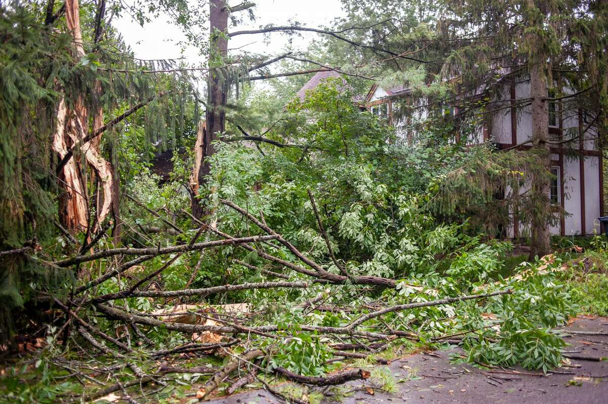 A Midland home belonging to Stacy Daniels is damaged following a storm on Sept. 13, 2021. His home was damaged from a lightning strike that hit some trees in his front yard.