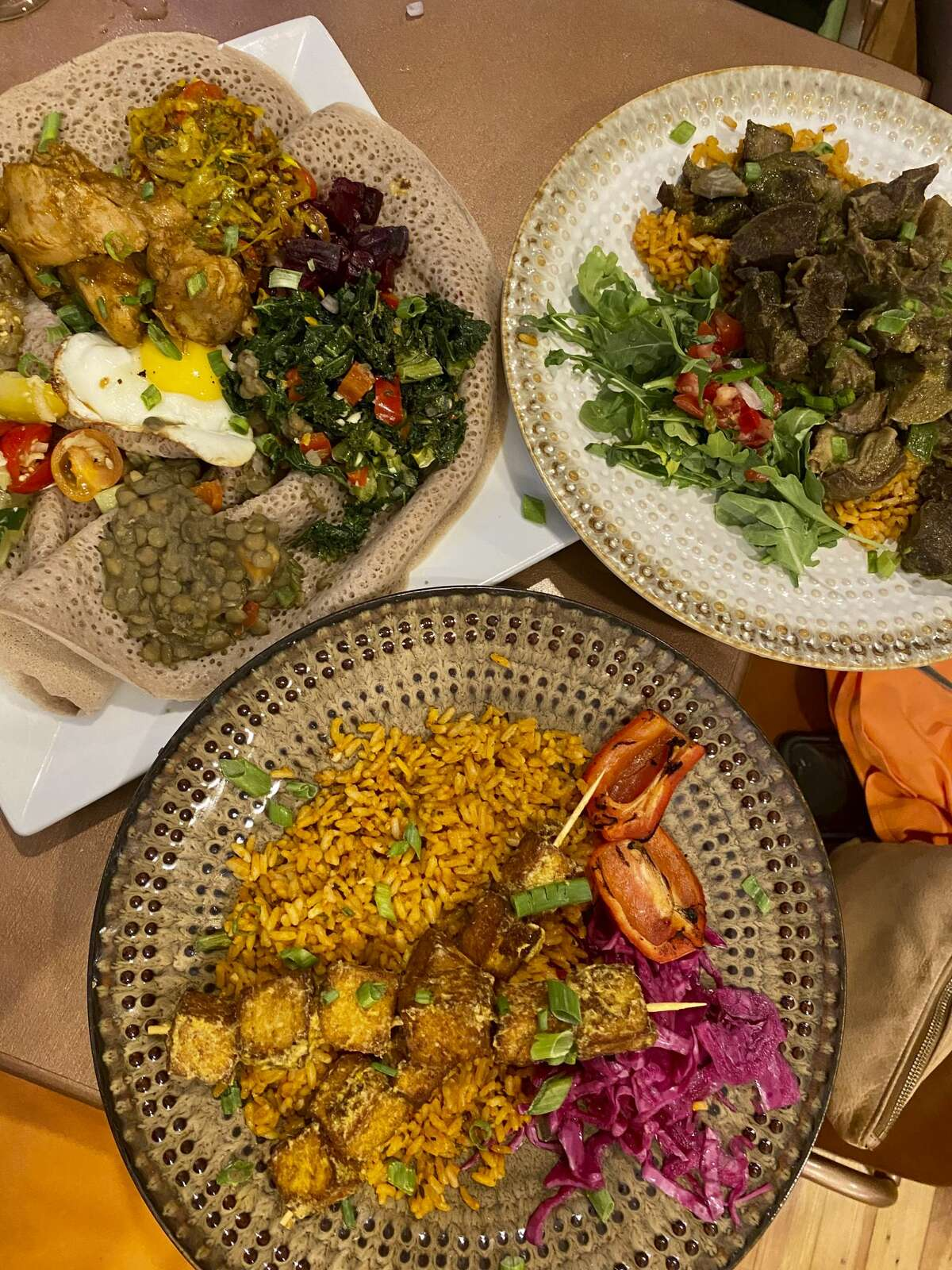 Kaleidoscopic plates of Afro Caribbean-inspired street food are a signature offering at Umana Yana, a newly reopened Albany restaurant.(Susie Davidson Powell/For the Times Union)