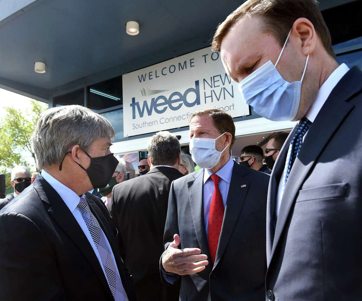 From left, Andrew Levy, Chairman and CEO of Avelo Airlines, speaks with U.S. Senators Richard Blumenthal and Chris Murphy with at a press conference announcing major expansion plans at Tweed New Haven Regional Airport on May 6, 2021.