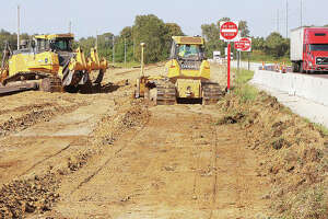 Construction workers on Tuesday were beginning to form a lane in the dirt for future traffic traveling on the Missouri side of U.S. 67 south of the Clark Bridge. The $4.1 million project will replace a nearly one-mile stretch of U.S. 67 southbound prone to flooding. The work is also expected to improve the safety and mobility at the U.S. 67 intersection with Riverlands Way.