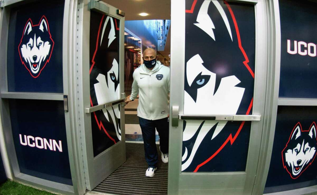 UConn Athletic Director David Benedict, who is coming up on his fifth anniversary of being hired, enters the Mark R. Shenkman Training Center on the campus in Storrs, Conn., on Thursday Mar. 4, 2021.
