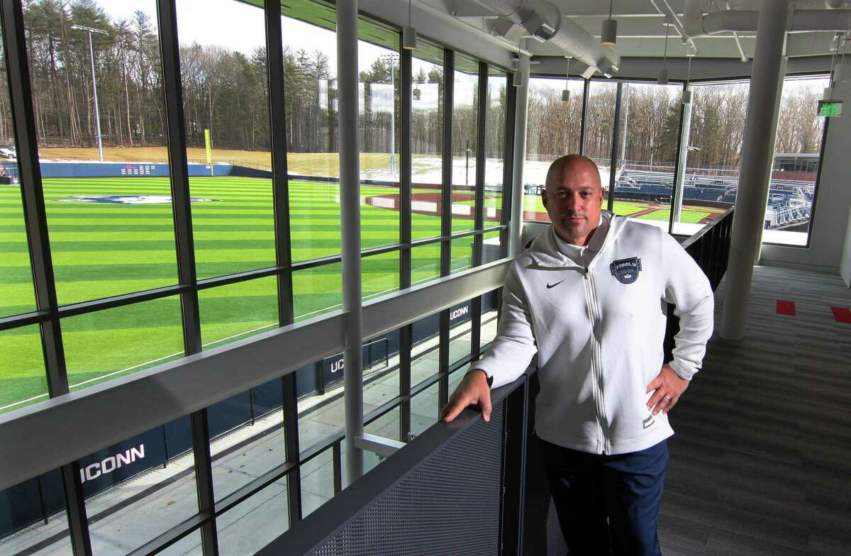 UConn Athletic Director David Benedict, poses inside the new Rizza Performance Center on the campus in Storrs, Conn., on Thursday Mar. 4, 2021. In the background is the Elliot Ballpark.