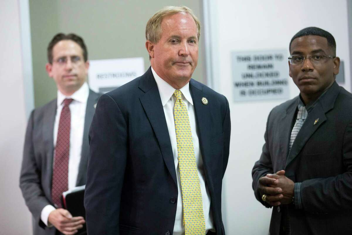 Texas Attorney General Ken Paxton arrives to a news conference at the Houston Recovery Center Thursday, Aug. 5, 2021 in Houston.