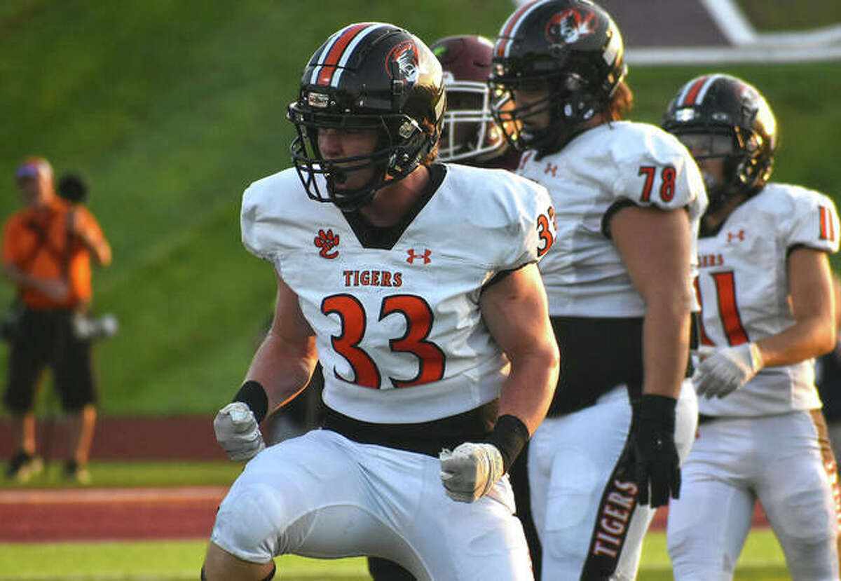 Edwardsville linebacker Dalton Brown is fired up after making a tackle for a loss against De Smet in Week 1.