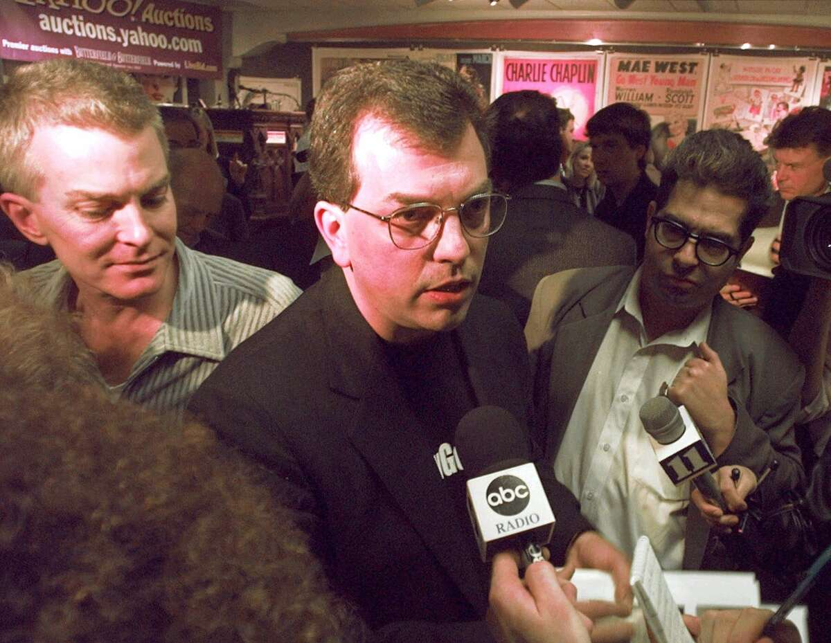 FILE: In this 1999 photo, Bob Enyart of Denver tells reporters that he will destroy several items of O.J. Simpson memorabilia he purchased at the sale of the former football star's possessions at Butterfield & Butterfield auction house Tuesday, Feb. 16, 1999, in Los Angeles' Hollywood district.