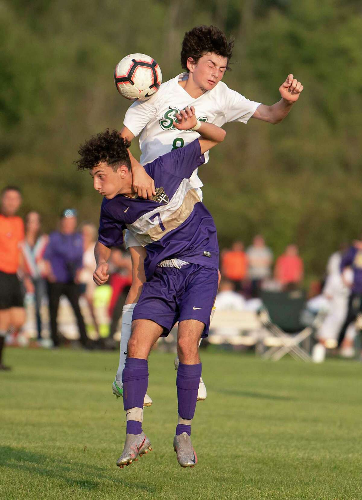 Christian Brothers Academy's Eric Najtellari, bottom, battles for the ball against Shenendehowa's Massi Bruno during a soccer game on Tuesday, Sept. 14, 2021 in Colonie, N.Y.