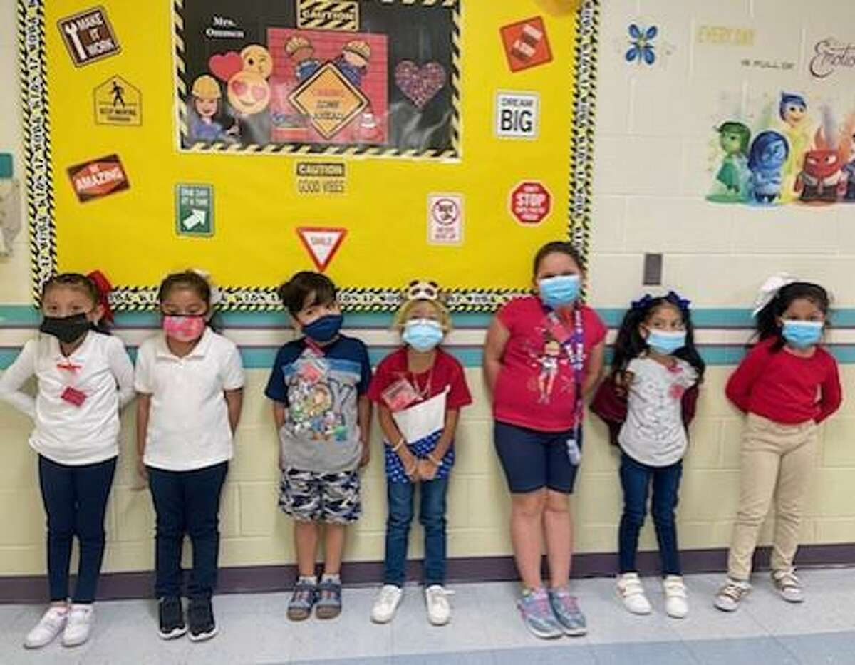 Students from Arndt Elementary School dressed in red, white and blue to commemorate the lives lost on Sept. 11, 2001 as well as fallen Laredo Marine Lance Cpl. David Lee Espinoza.