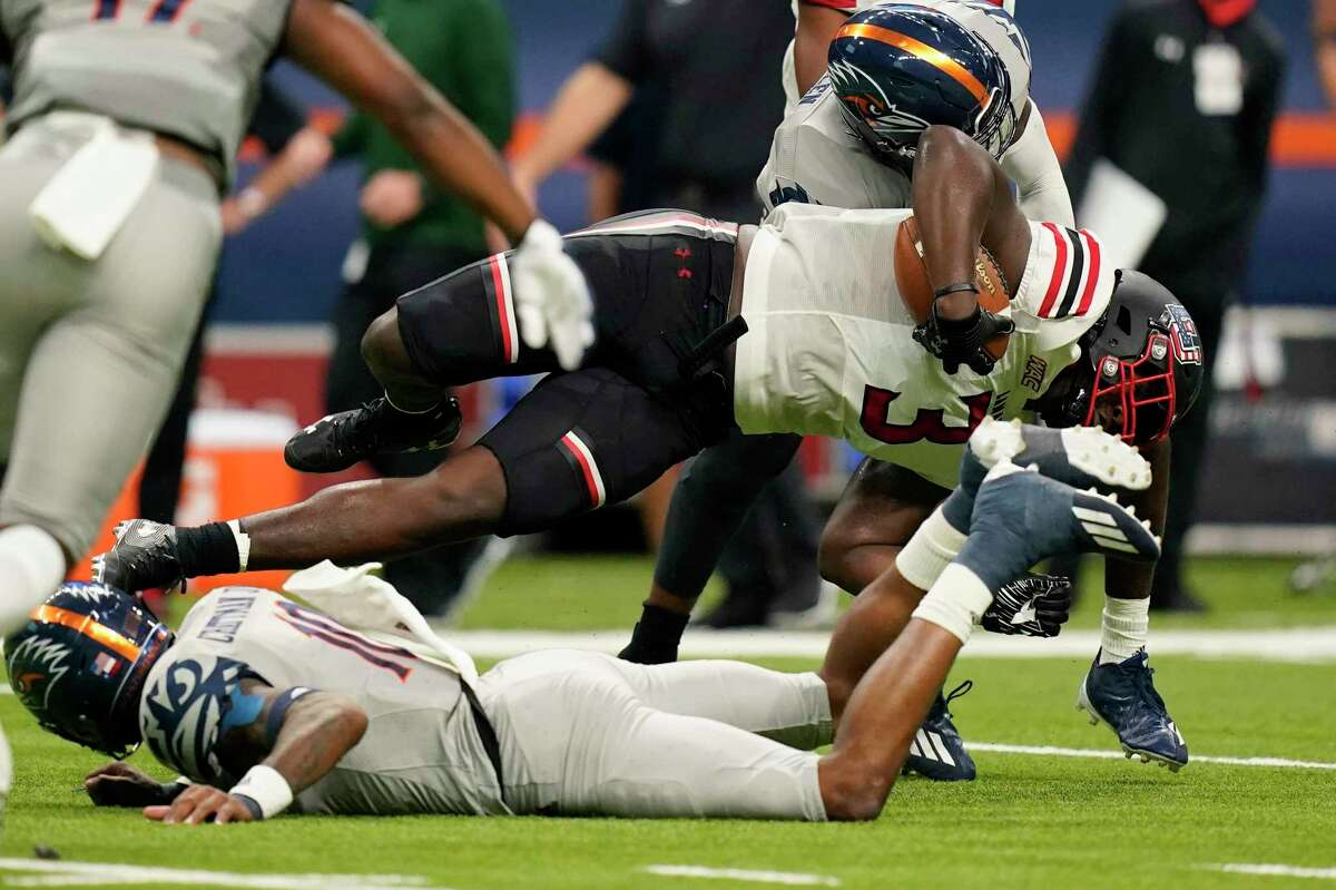 Lamar tight end Jeremy Davis (3) is sent to the turf by UTSA safety Clifford Chattman (10) during the first half of an NCAA college football game Saturday, Sept. 11, 2021, in San Antonio. (AP Photo/Eric Gay)