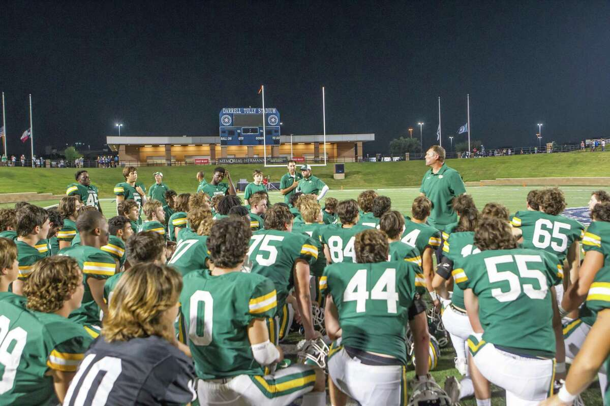Stratford coach Todd Rankin talks to the team following its 21-13 win over Fort Bend Dulles at Tully Stadium on Sept. 11.