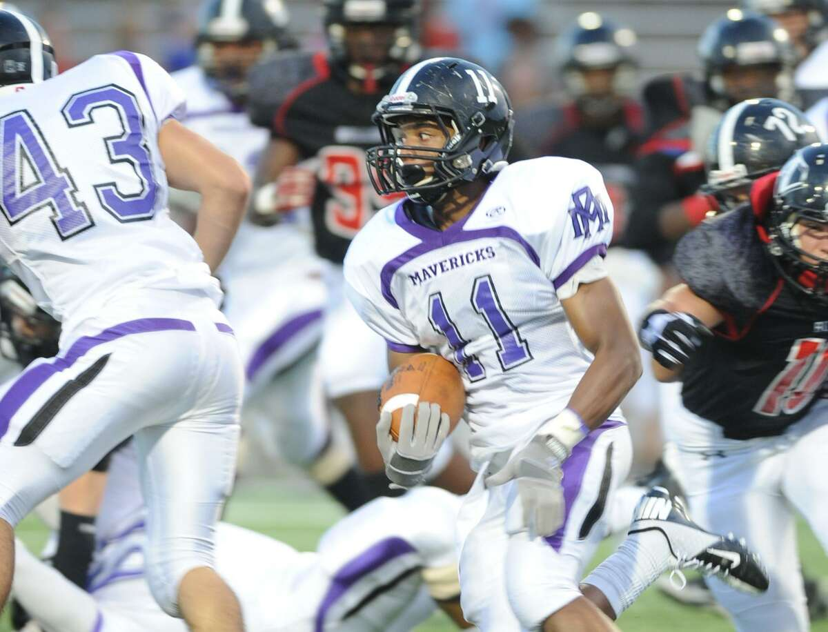 Roemello Burros, wearing number 11, runs the ball during his time playing for the Morton Ranch Mavericks in Katy. He graduated from the school in 2014.