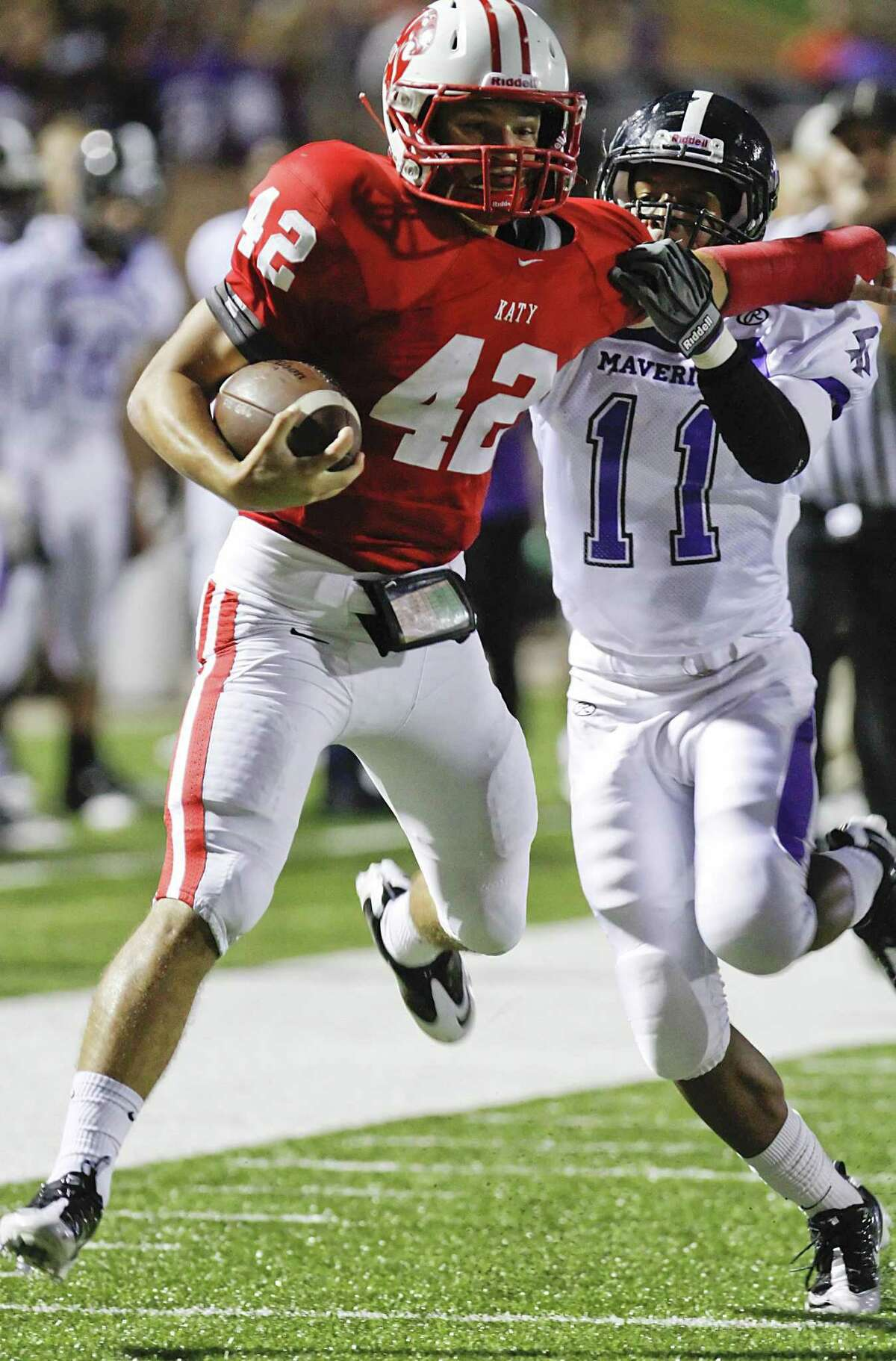 Katy running back Alex Fisher fights off Roemello Burros of Morton Ranch High Schoolas the two teams faced off in District 19-5A play at Rhodes Stadium in Katy on September 27, 2012.