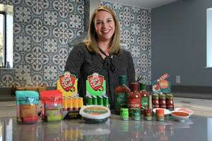 Elysia Trevino-Gonzales is board chair of Twang, a local company that makes spicy condiments for use with beverages such as beers and margaritas — even coffee.