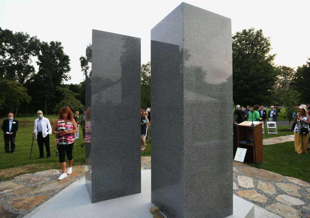Two massive granite columns atop a pentagonal base are unveiled Tuesday as the new 9/11 memorial at Oak Lawn Cemetary & Arboretum in Fairfield.