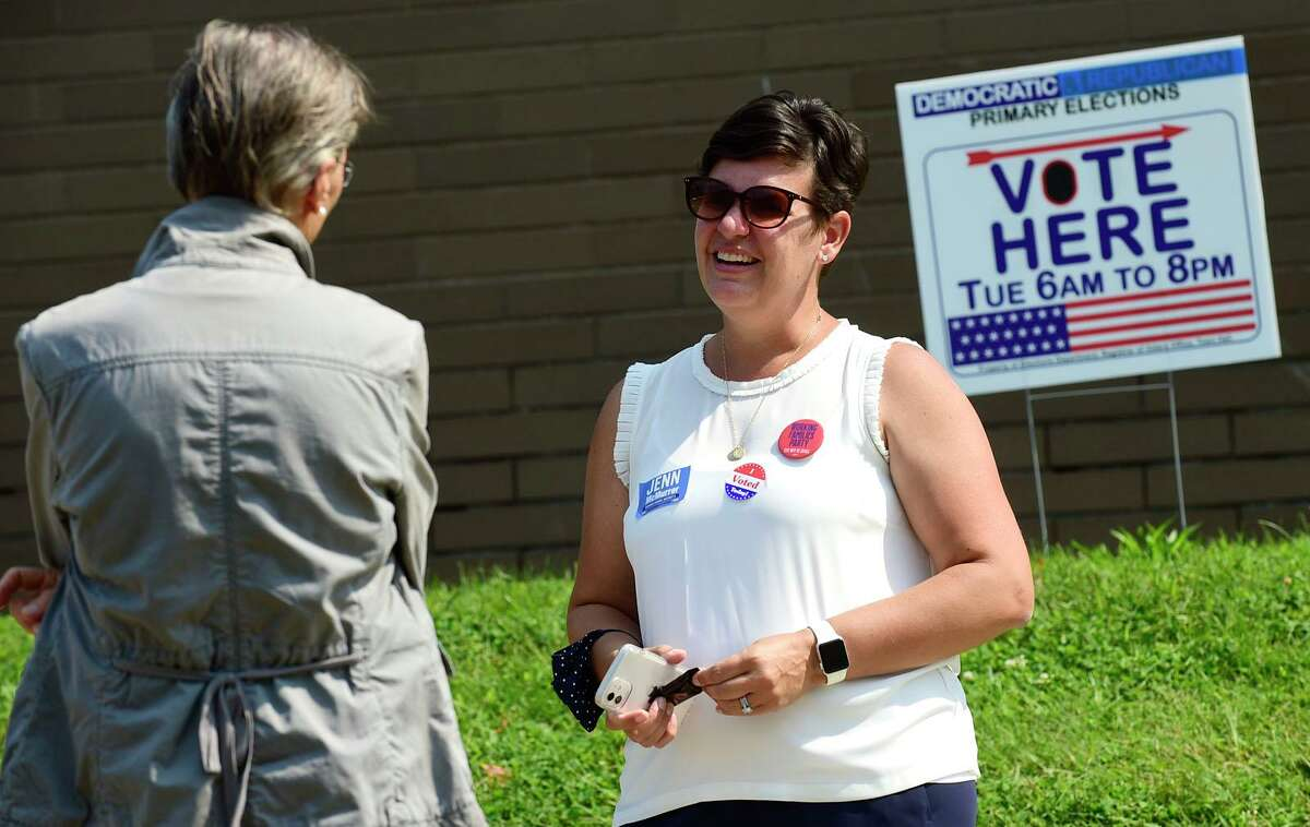 Challenger Jenn McMurrer campaigns in front of Marvin Elementary School Tuesday.