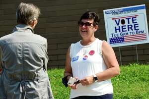 Challenger Jenn McMurrer campaigns in front of Marvin Elementary School Tuesday, September 14, 2021, as voters cast their ballots for the Common Council seat for District C in the primary election in Norwalk, Conn.