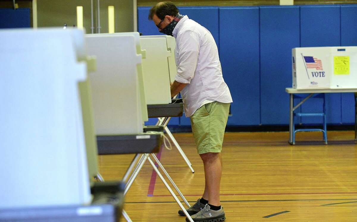 Voters including Yari Usherov cast their ballots in the District C primary election featuring incumbent John Kydes and challenger Jenn McMurrer Tuesday, September 14, 2021, at Marvin Elementary School in Norwalk, Conn.