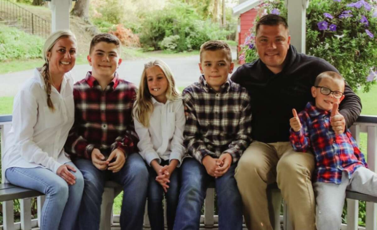 Kyle Van De Water, a Dutchess County lawyer and Army veteran who ran for Congress in 2020, died at age 41. He is shown here with his wife Melissa and their four children. (Photo is courtesy of Van De Water Family Fund.)