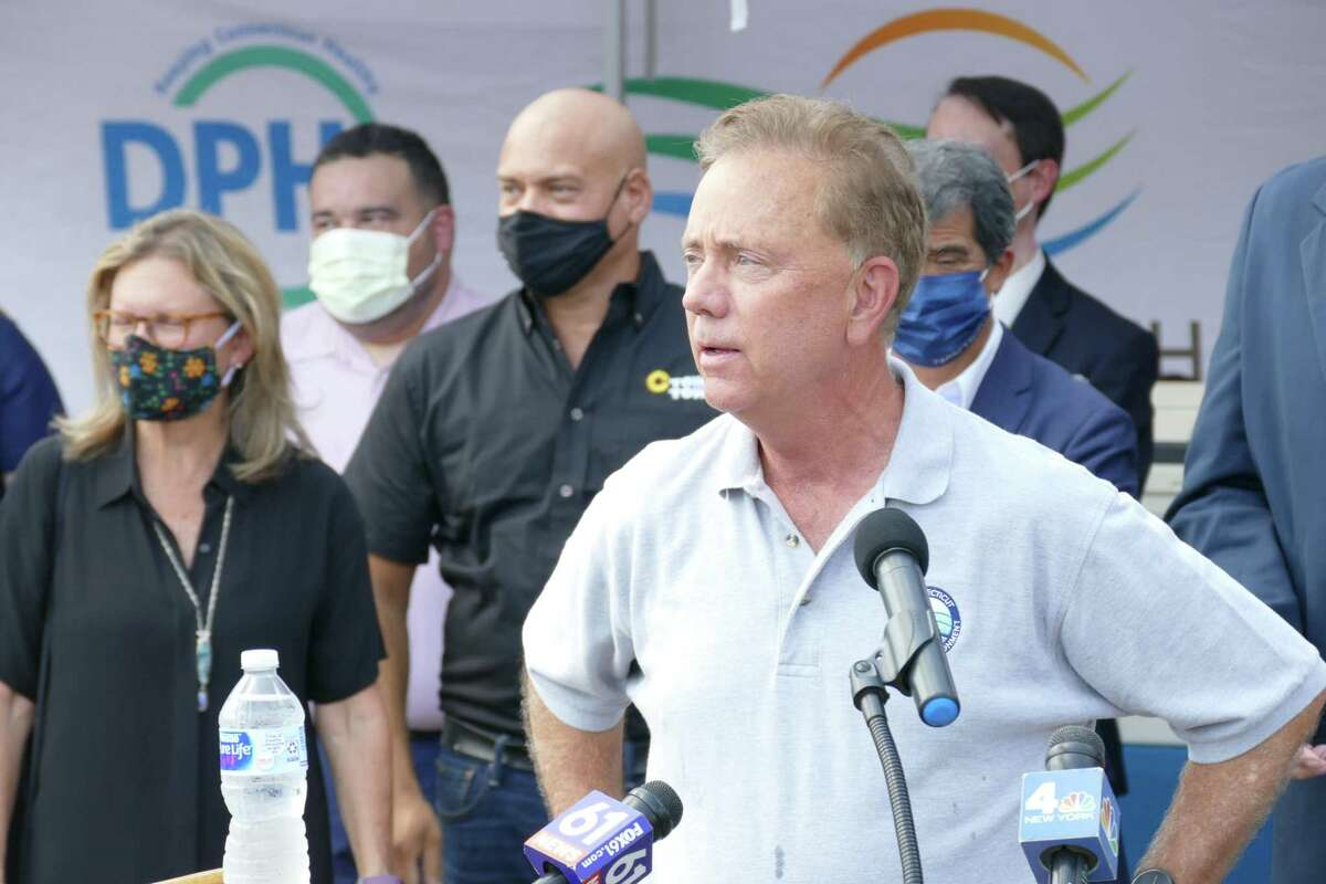 Gov. Ned Lamont speaks aat a news conference outside the CTown grocery store on North Street in Danbury late last month.