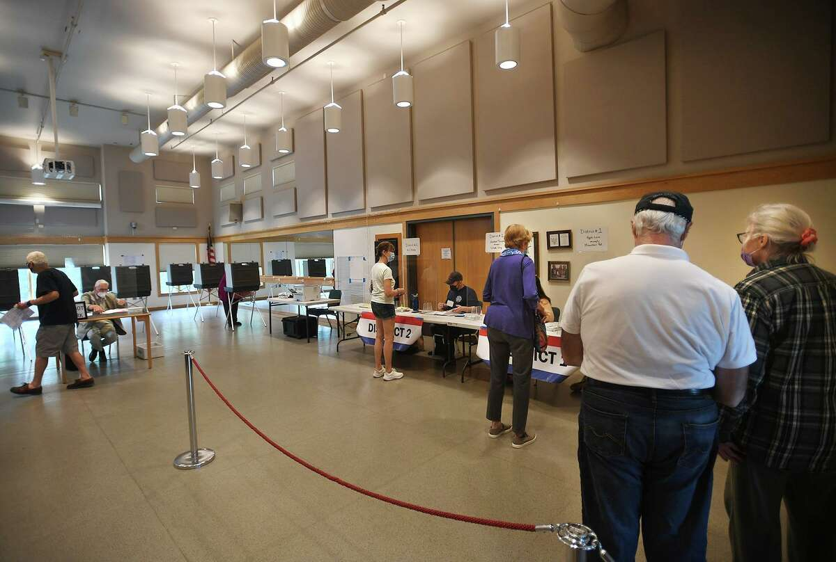 Voters cast their ballots in Tuesday's Democratic primary for first selectman at the Redding Community Center in Redding.