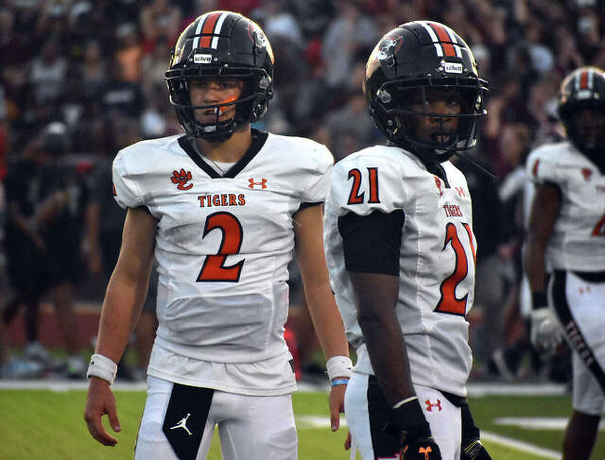 Edwardsville quarterback Jake Curry, left, and running back Jordan Bush look to the sideline for a play during Week 1 against De Smet in St. Louis.