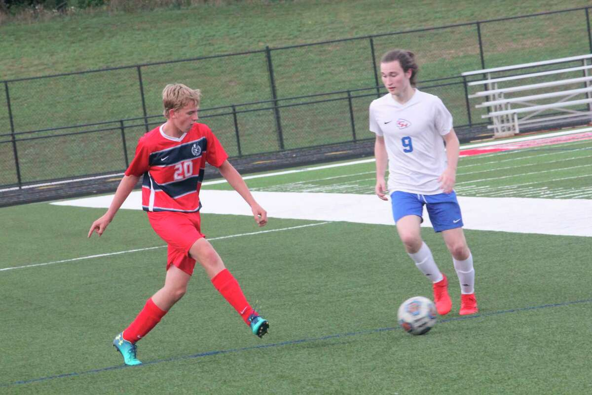 Big Rapids' Carter Leyder (20) looks to put a move on Chippewa Hills' Scotty Miller during Tuesday's soccer game at Cardinal Stadium. (Pioneer photo/John Raffel)