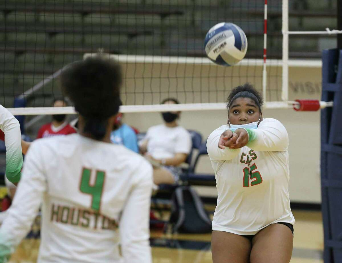 Sam Houston's DeMyrea Moore (15) sets up a play against Jefferson during their volleyball match at Alamo Convocation Center on Tuesday, Sept. 14, 2021. Jefferson routed Sam Houston, 3-0 in sets, to take the win.