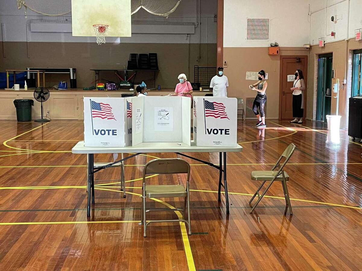 Voters go to the polls at 60 Putnam Avenue in Hamden, Conn. to cast ballots in the Democratic primary. Sept. 14, 2021