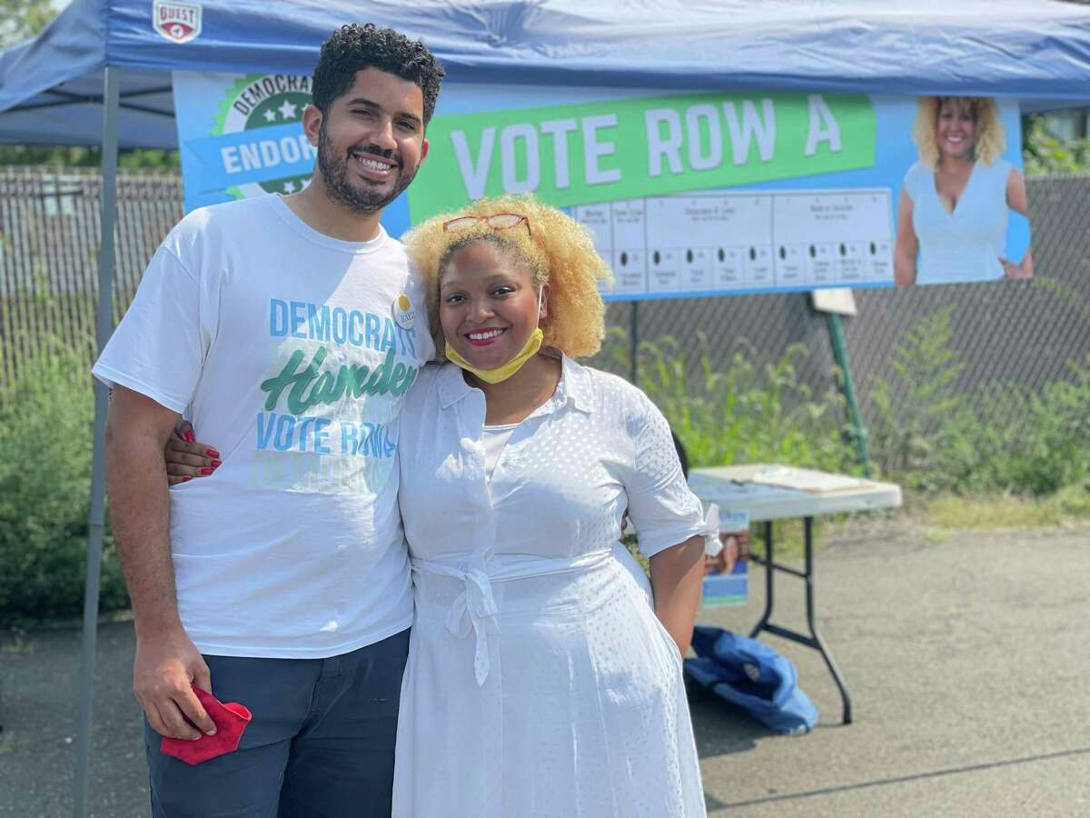 At-large Councilwoman Dominique Baez, right, with her husband Joe Baez outside the Keefe Community Center in Hamden on Sept. 14, the day of a contentious Democratic primary.