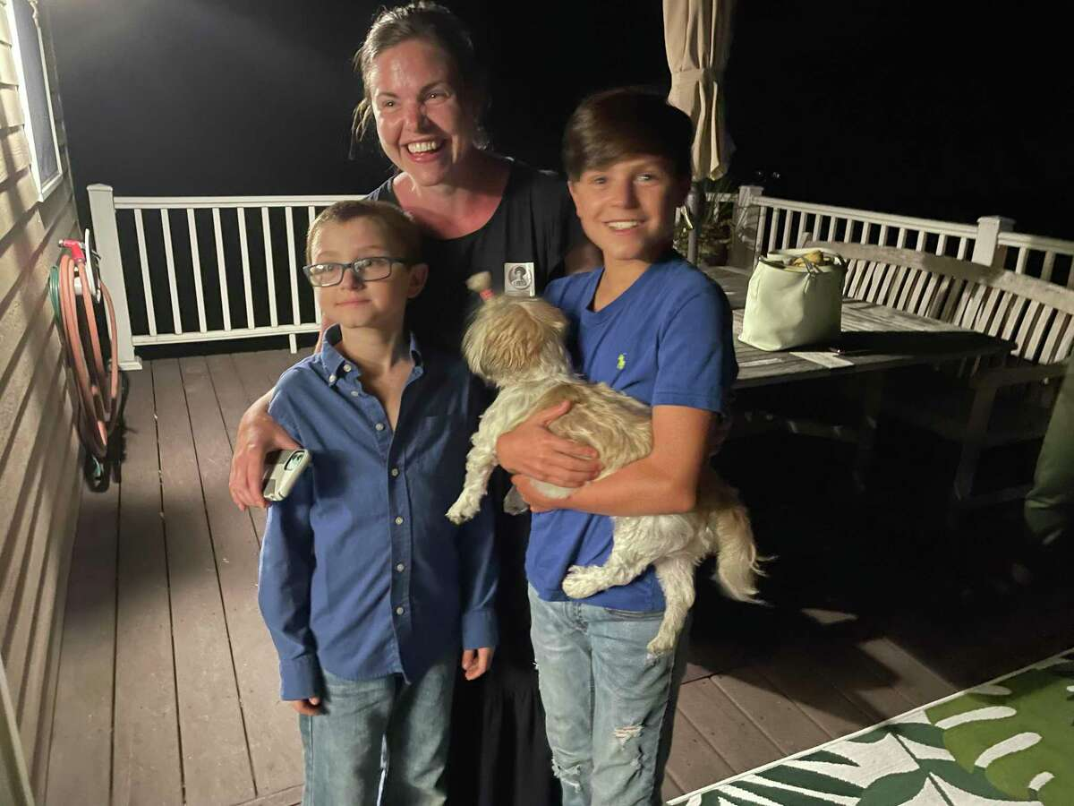 Lauren Garrett celebrates her win in Hamden's mayoral Democratic primary with sons Bobby, left, and Connor, right, and their dog, Penelope, Sept. 14, 2021.