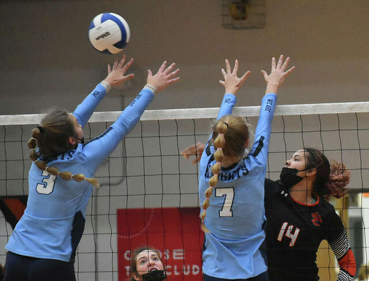 In this file photo, Edwardsville's Sydney Harris slams a kill past two Mater Dei defenders during the semifinals of the Tiger Classic inside Lucco-Jackson Gymnasium.