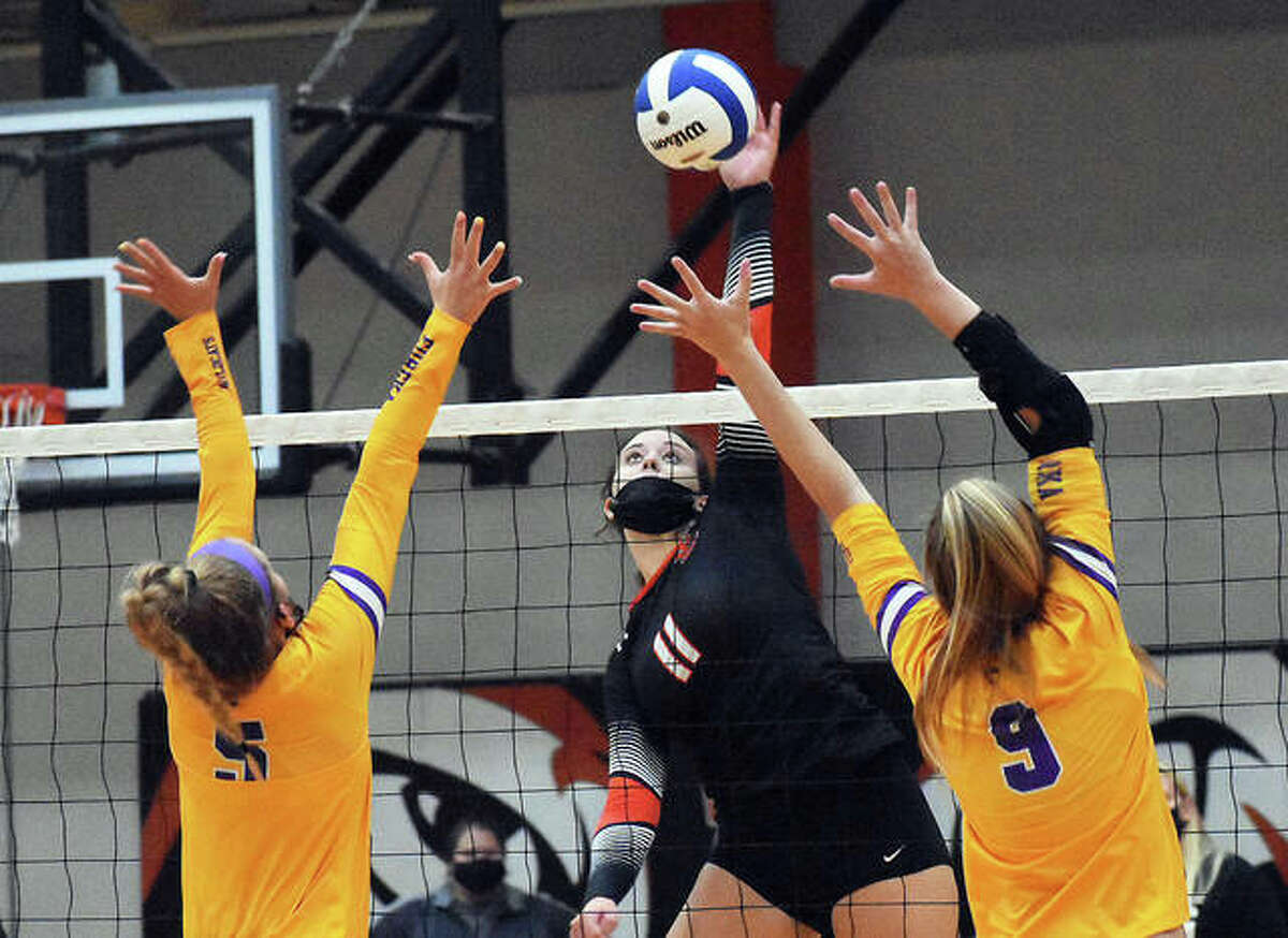 In this file photo, Edwardsville's Gabby Saye slams a kill past two Eureka defenders during the championship match of the Tiger Classic inside Lucco-Jackson Gymnasium.