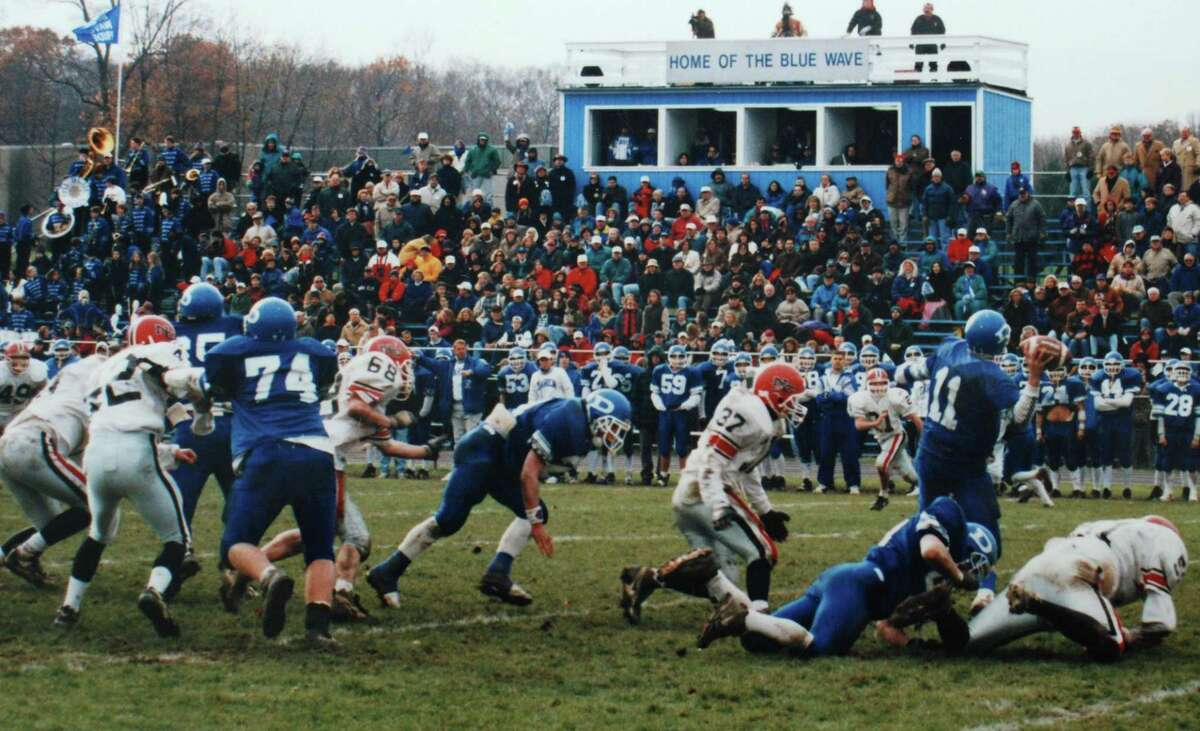 New Canaan's Brian Wilderman (37) in action against Darien in the annual Turkey Bowl football game between the rivals during the 1990s.
