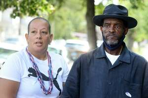 City Council members Eneida Martinez and Ernie Newton stand together outside Dunbar School, in Bridgeport, Conn. Sept. 14, 2021. Martinez and Newton seek to continue representing the 139th district in Tuesday's Democratic primary.